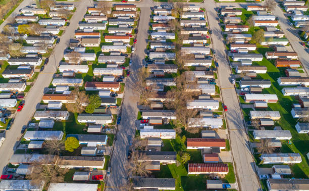 manufactured housing Aerial view looking down on vast trailer park, mobile homes.