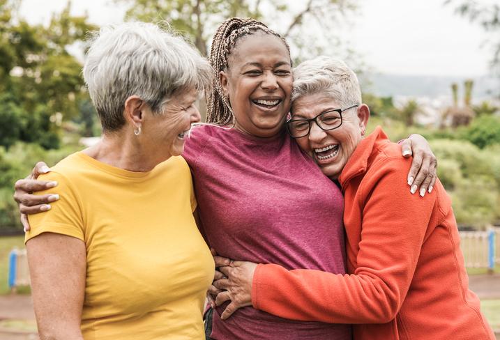 Happy multiracial senior women having fun together outdoor